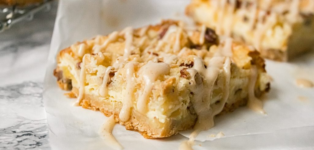 Easy Pineapple Pecan Cheesecake Dessert Bars Recipe with Brown Butter Coconut Icing - Chenée Today