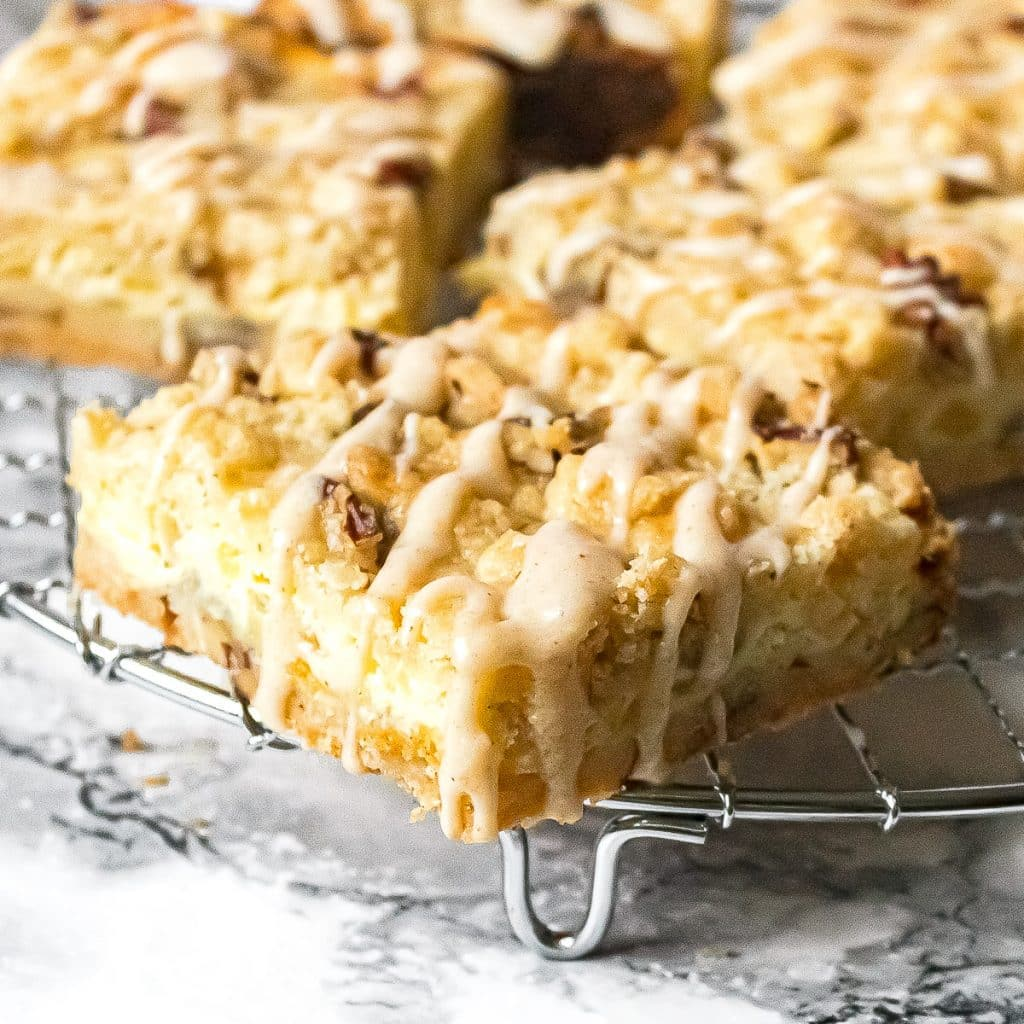 close up of pineapple bars with coconut drizzle