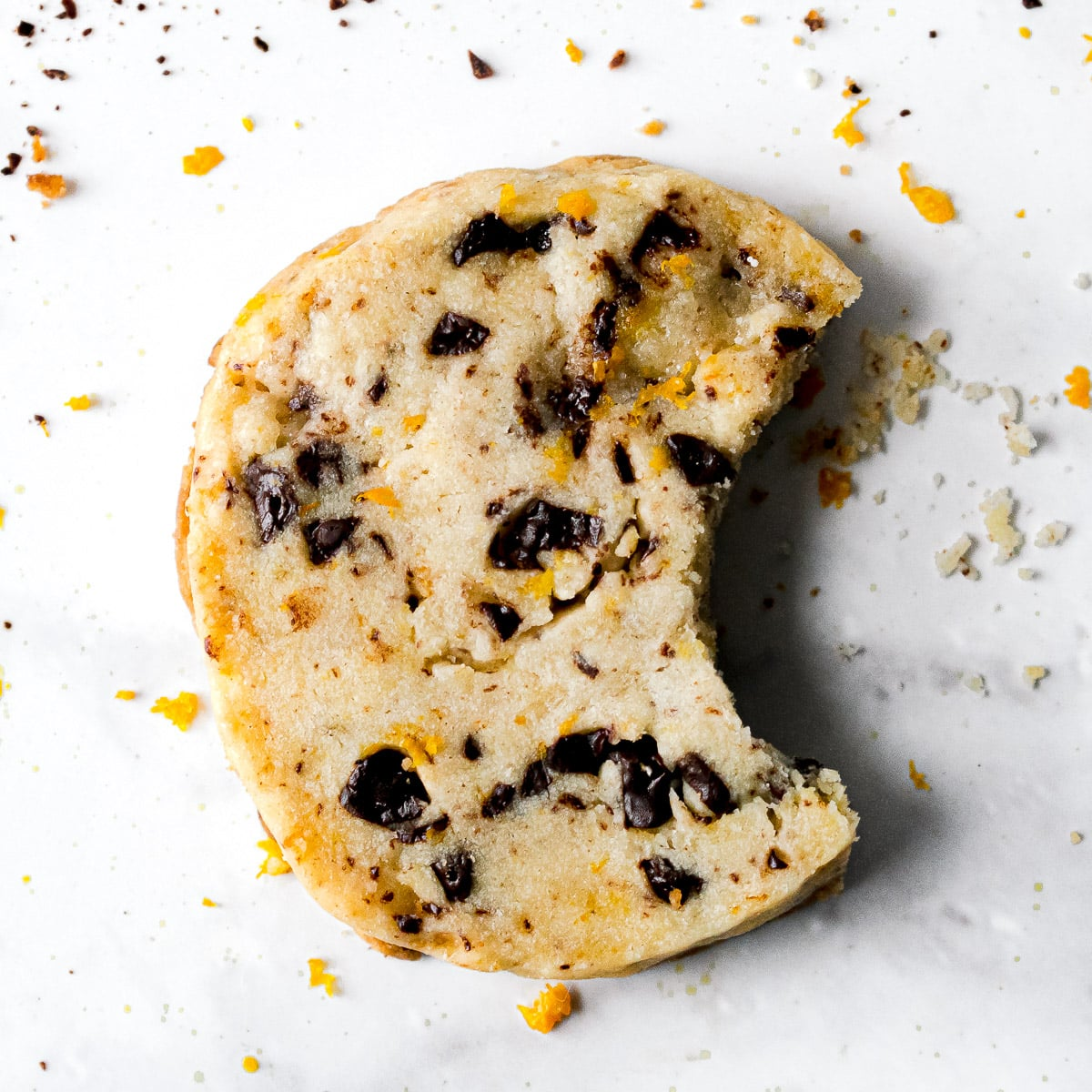 chocolate orange cookie with a bite taken out