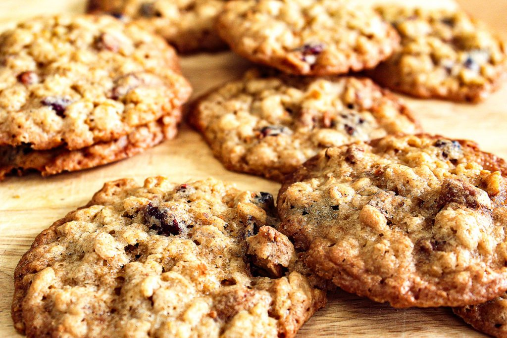 close up of oatmeal cranberry pecan cookies