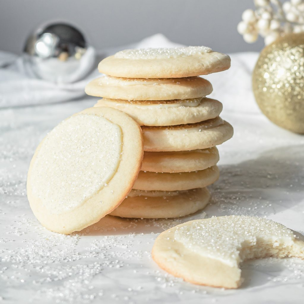stack of peppermint white chocolate sugar cookies with one cookie bit