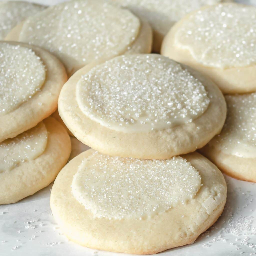 overhead shot of peppermint white chocolate sugar cookies on parchment paper
