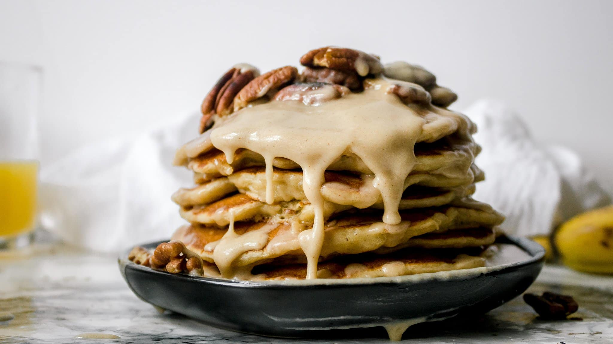 Fluffy Banana Pancakes with Pecans and Maple Brown Butter Glaze
