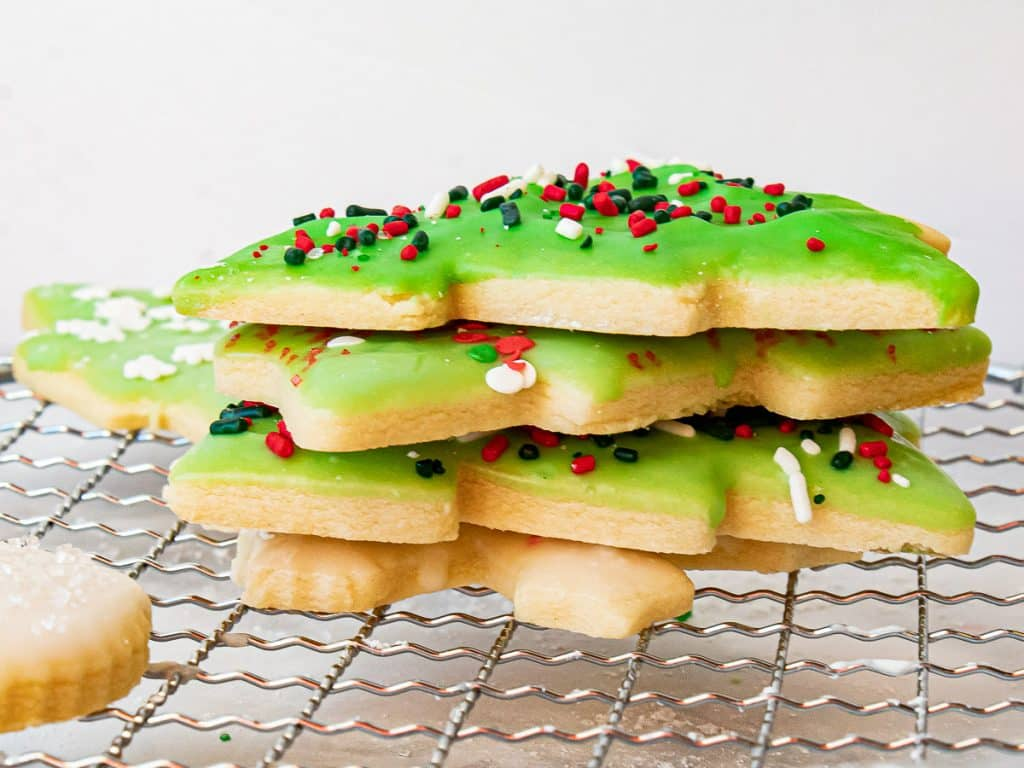stack of decorated sugar cookies on a wire rack