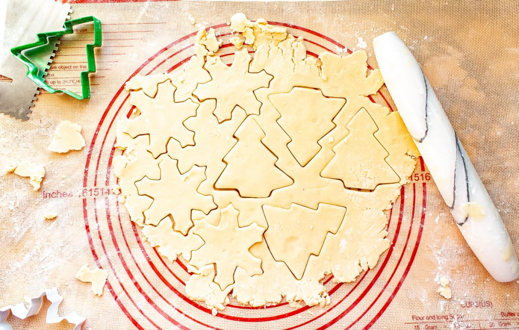 sugar cookie dough cut with cookie cutters