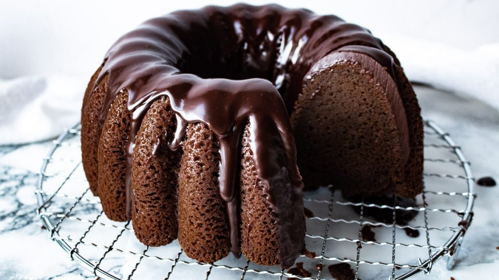 chocolate sour cream pound cake with a few pieces cut out