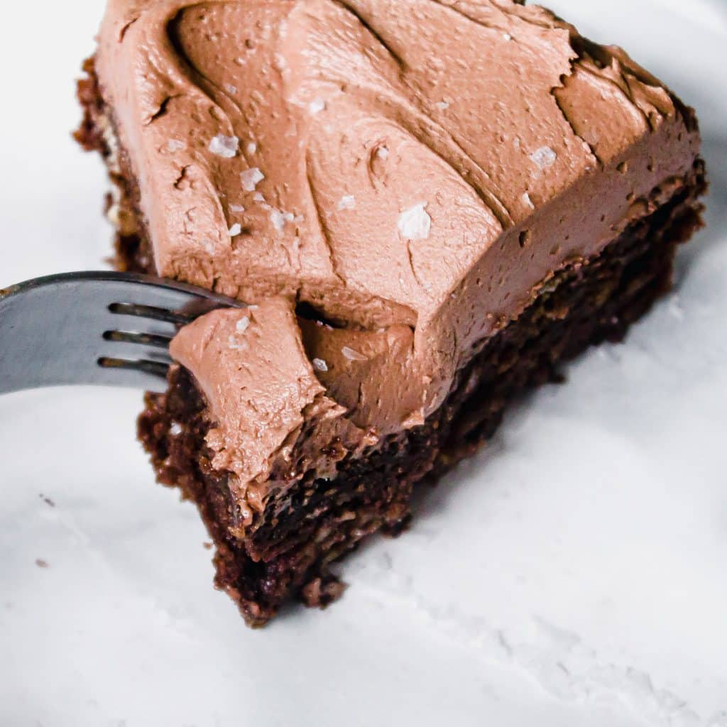 close up of a slice of mini chocolate cake being cut with a fork