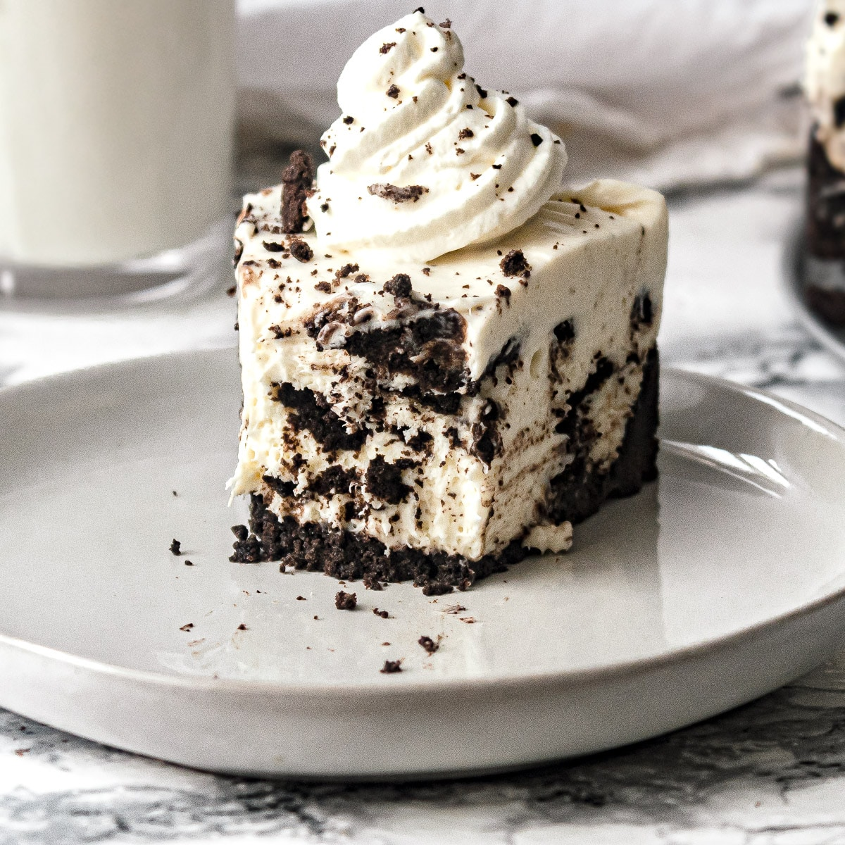 no bake Oreo cheesecake slice with a bite missing