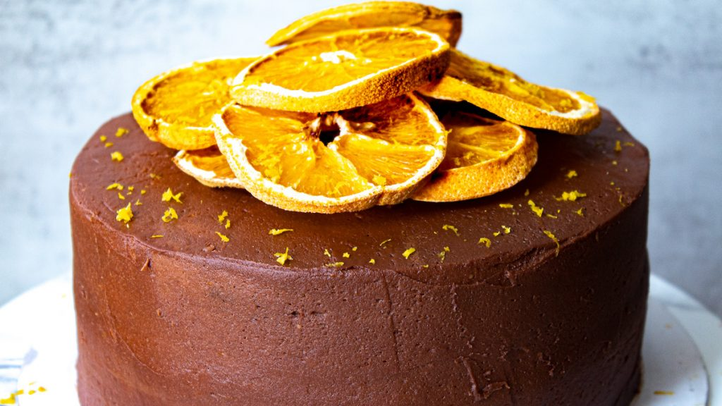 frosted chocolate orange cake decorated with dehydrated orange slices