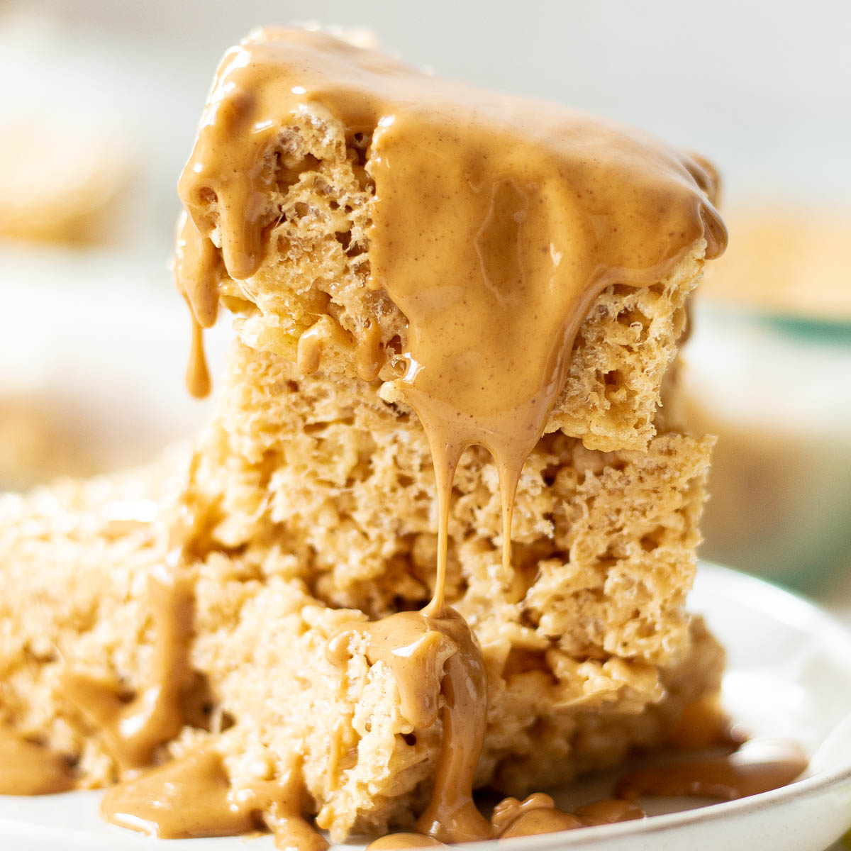 peanut butter rice krispie treats drizzled in peanut butter