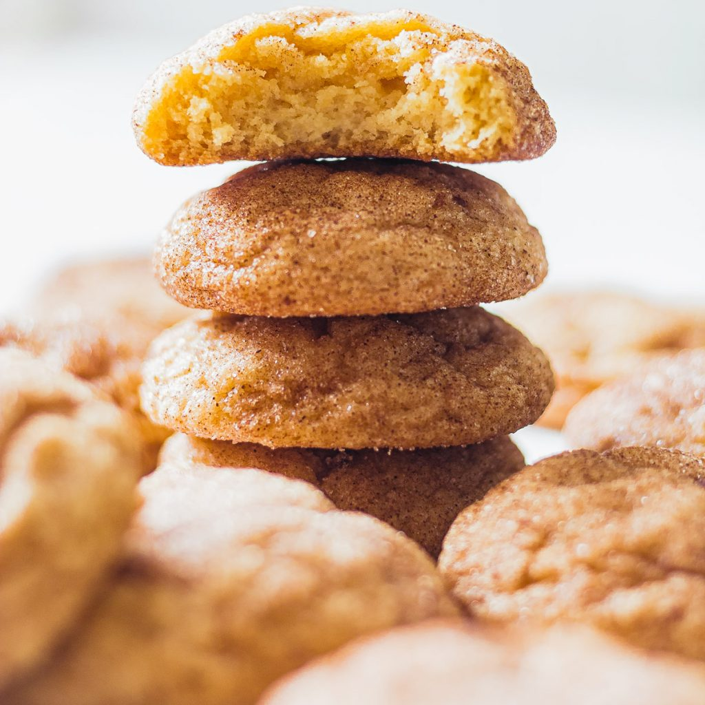 stack of snickerdoodles with a bite taken from one