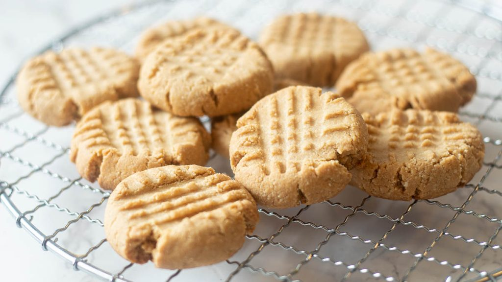 vegan almond flour peanut butter cookies on a wire rack