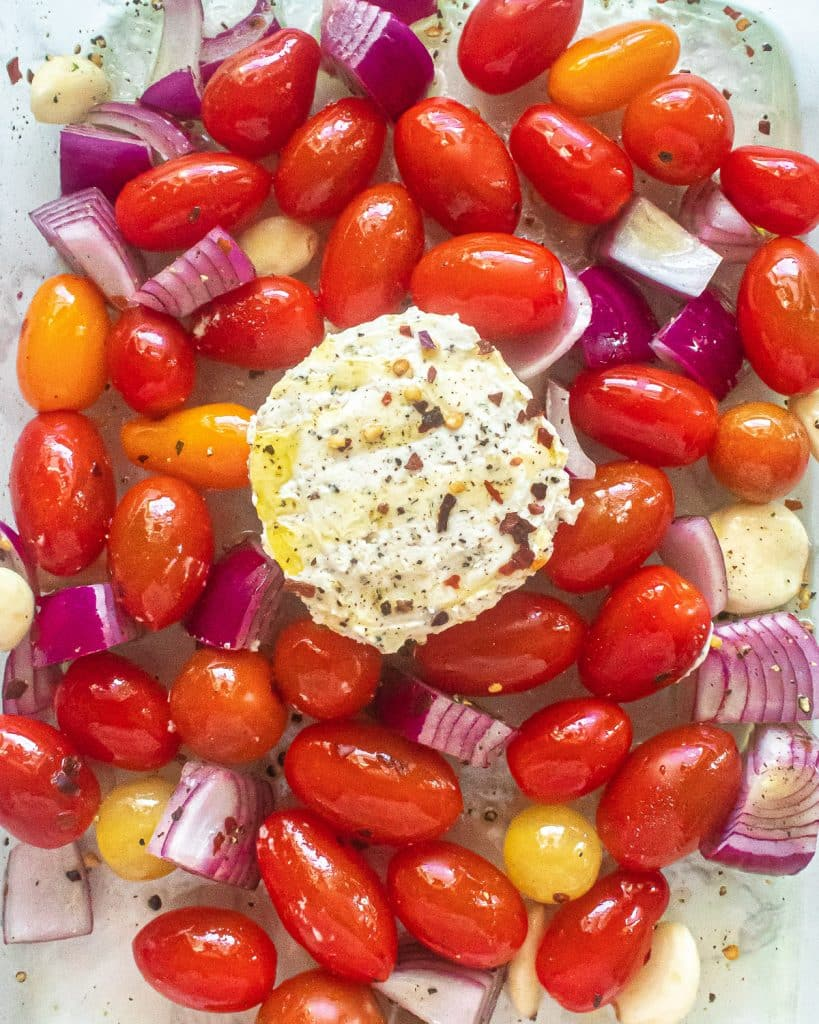 boursin cheese, tomatoes, onions, and garlic in a pan