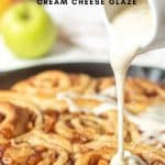 pouring glaze over cinnamon rolls with apple pie filling