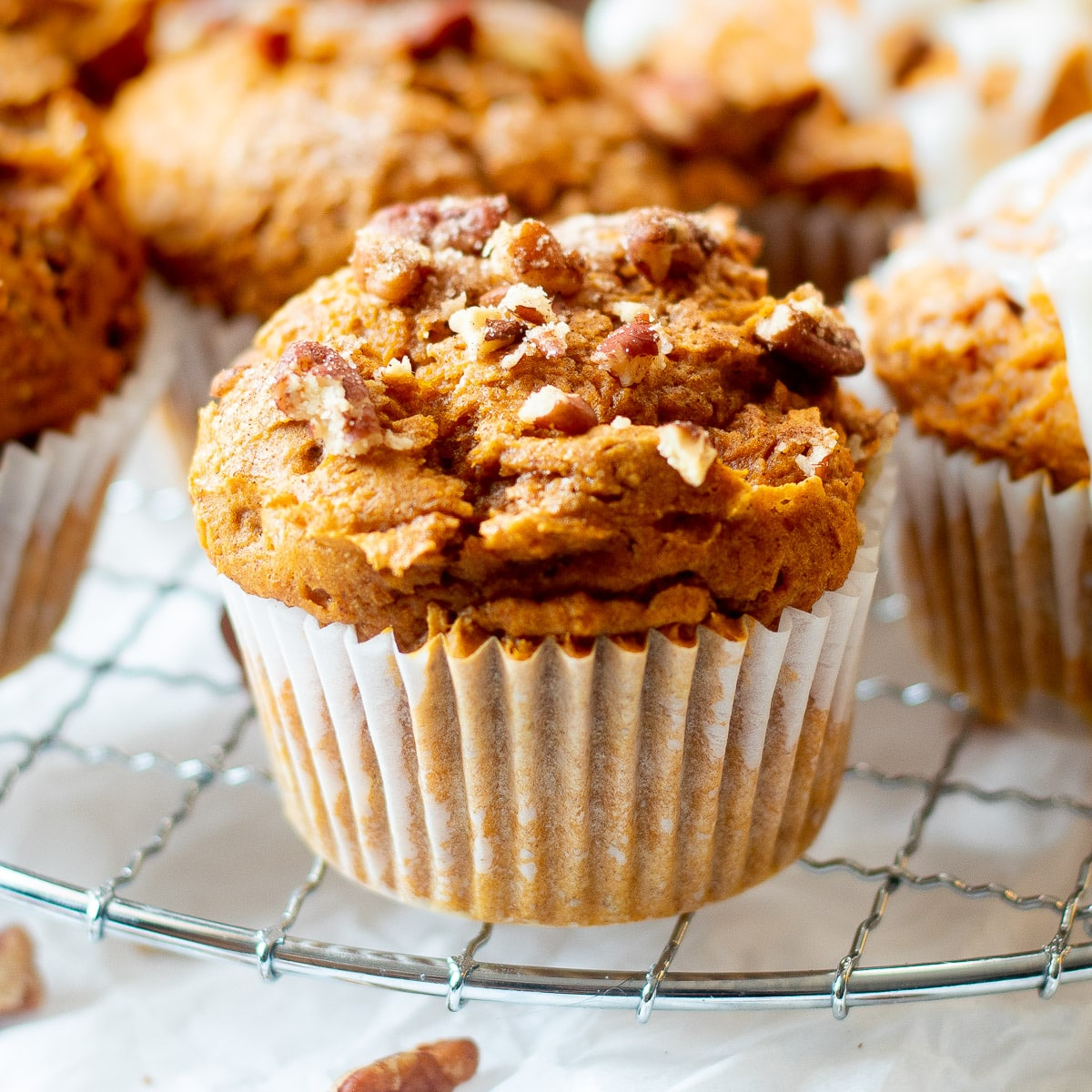 close up of easy 3 ingredient pumpkin muffins on wire rack