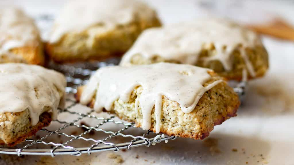 Earl Grey Scones on a wire rack drizzled with vanilla bean glaze